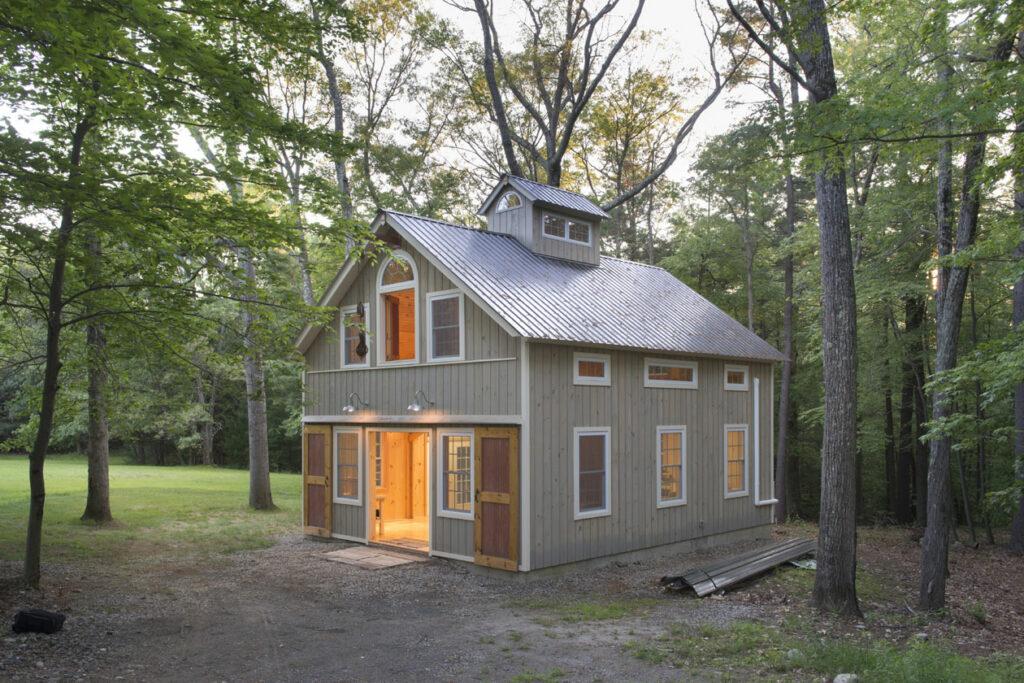 Geobarns, Massachusetts Woodworking Barn, exterior entry barn doors, windows, hayloft door, wooded site