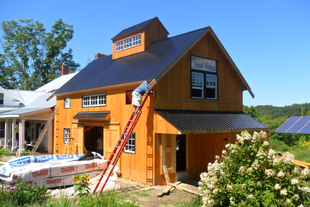 barn apartment, exterior, vermont farmhouse, pond, porch, natural siding, windows