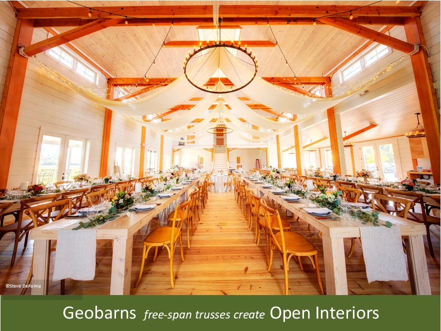 A picture of the interior of the wedding barn at Smuggler's Notch in Vermont, showing a luminous, open interior and banquet setting